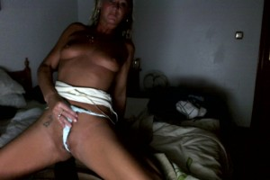 Natalie K stuffing a pair of white panties