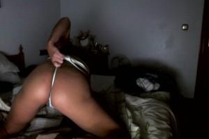 Natalie K stuffing a pair of white panties