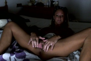 Natalie on the bed spreading